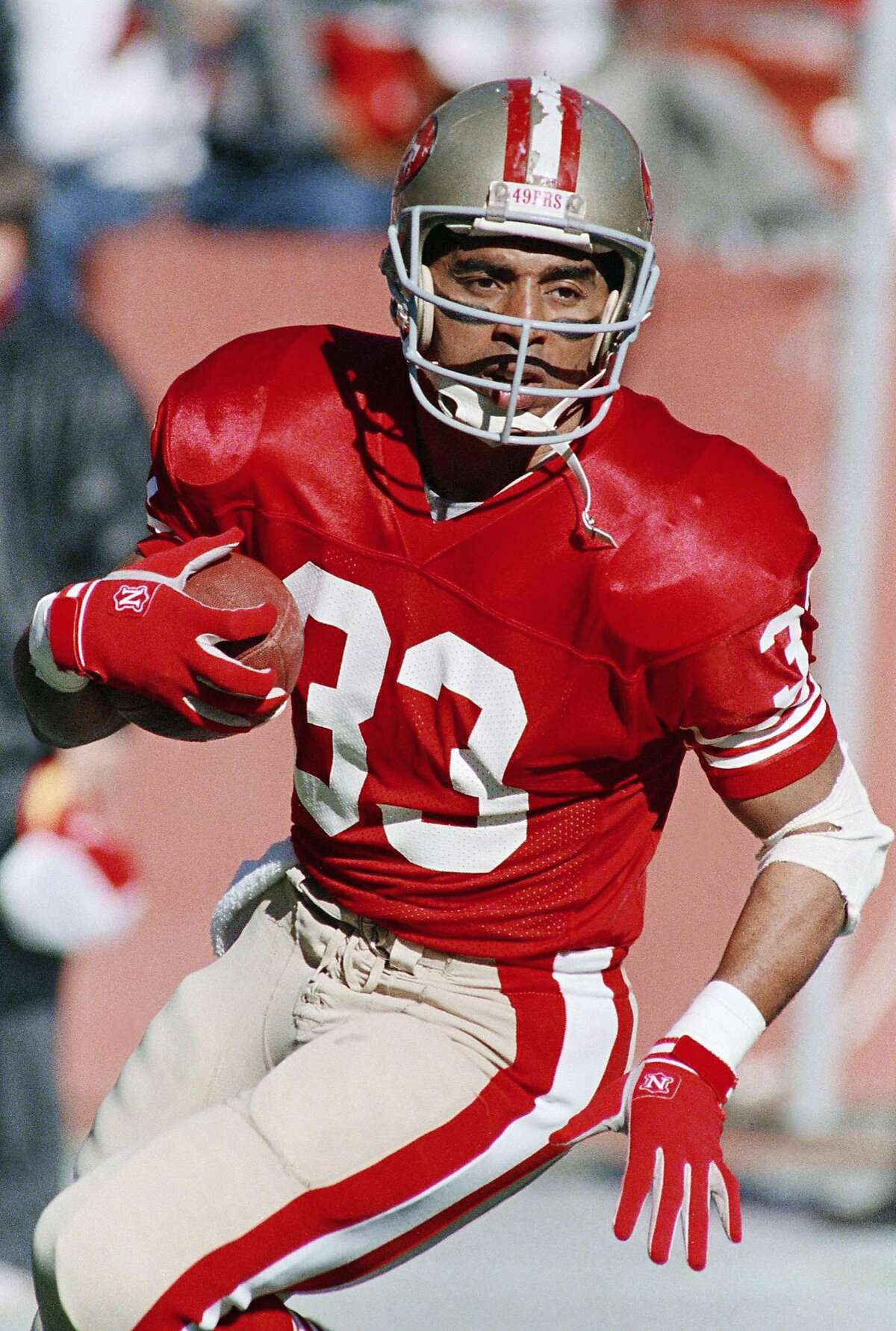 San Francisco 49ers running back Roger Craig carries the ball during the 49ers NFC Divisional playoff game against the Minnesota Vikings, Jan. 1, 1989, San Francisco, Calif. The 49ers will face the Cincinnati Bengals in Super Bowl XXIII. (AP Photo/John Gaps)