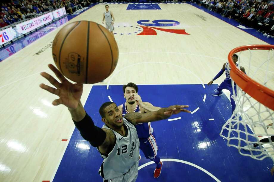 San Antonio Spurs' LaMarcus Aldridge (12) goes up for a shot past Philadelphia 76ers' Dario Saric (9) during the first half of an NBA basketball game, Wednesday, Jan. 3, 2018, in Philadelphia. (AP Photo/Matt Slocum) Photo: Matt Slocum, Associated Press / Copyright 2018 The Associated Press. All rights reserved.