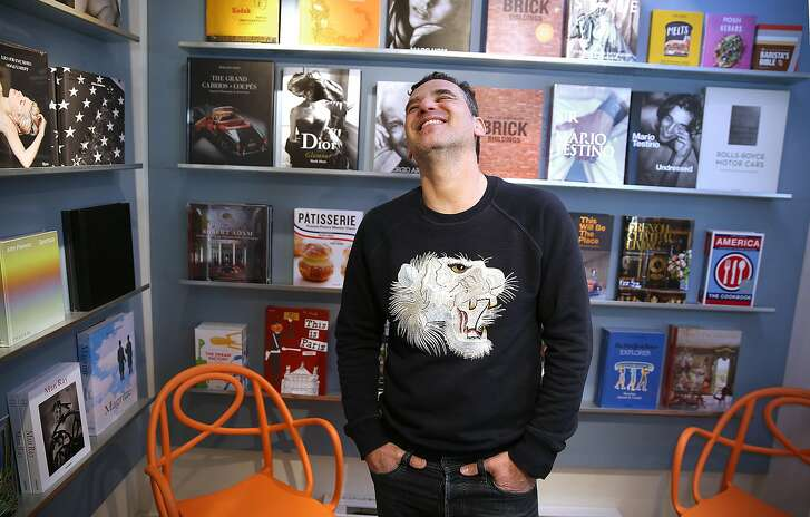 Juicy News owner Mo Salimi shows the reading room of his shop on Thursday, December 21, 2017, in San Francisco, Ca.