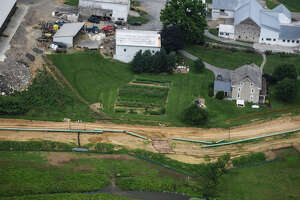 Pipes for the Sunoco Mariner East 2 pipeline are placed in South Lebanon Township, Pa., in July. Pennsylvania regulators announced Wednesday they have ordered Sunoco to halt construction.