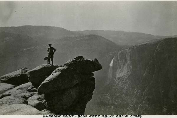 """Caption: """"Glacier Point - 3000 Feet Above Camp Curry,"""" c. 1917. William McCarthy poses atop Glacier Point, overlooking Yosemite Valley. Glacier Point, on the south wall of the valley 3,200 feet above what is now known as Half Dome Village, provides panoramic views of the valley and many of its features.     [Caption source: California State Archive]"""