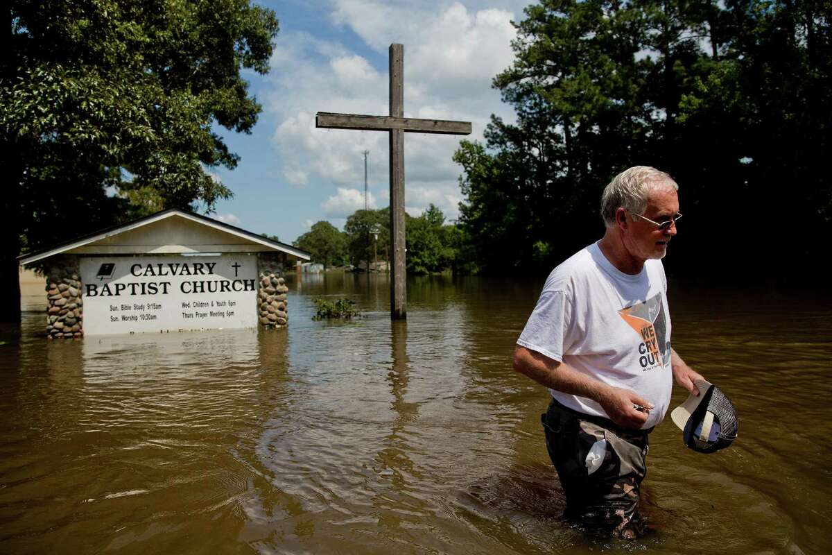 Pastor John Fortenberry surveys flood damage outside the Calvary Baptist Church in Deweyville in this Sept. 5 photo. A Federal Emergency Management Agency rule change means religious institutions that provide service to their broader local communities can immediately be eligible for Harvey aid, according to newly published FEMA documents.