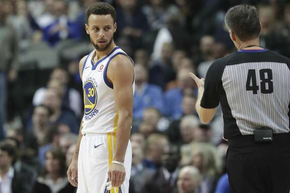 Golden State Warriors guard Stephen Curry reacts to a call during the first half of an NBA basketball game against the Dallas Mavericks in Dallas, Wednesday, Jan. 3, 2018. (AP Photo/LM Otero)