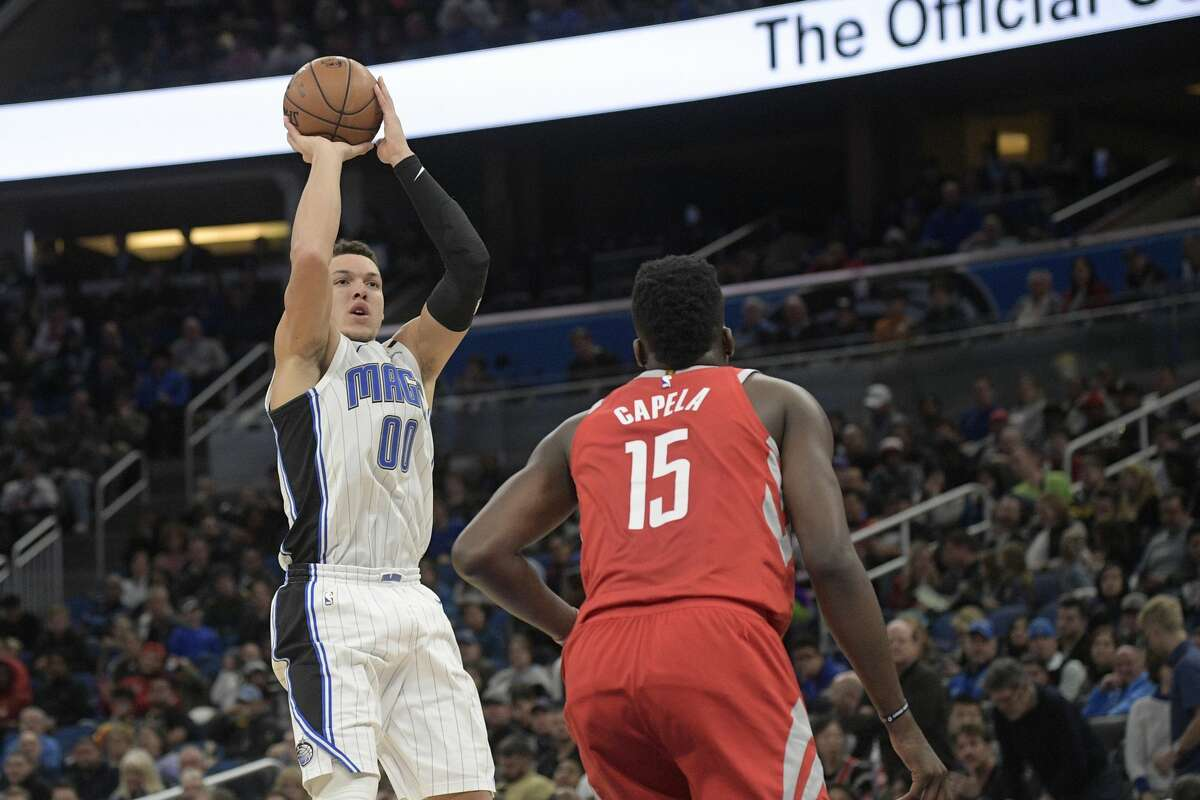 Orlando Magic forward Aaron Gordon (00) goes up for a shot in front of Houston Rockets center Clint Capela (15) during the first half of an NBA basketball game Wednesday, Jan. 3, 2018, in Orlando, Fla. (AP Photo/Phelan M. Ebenhack)