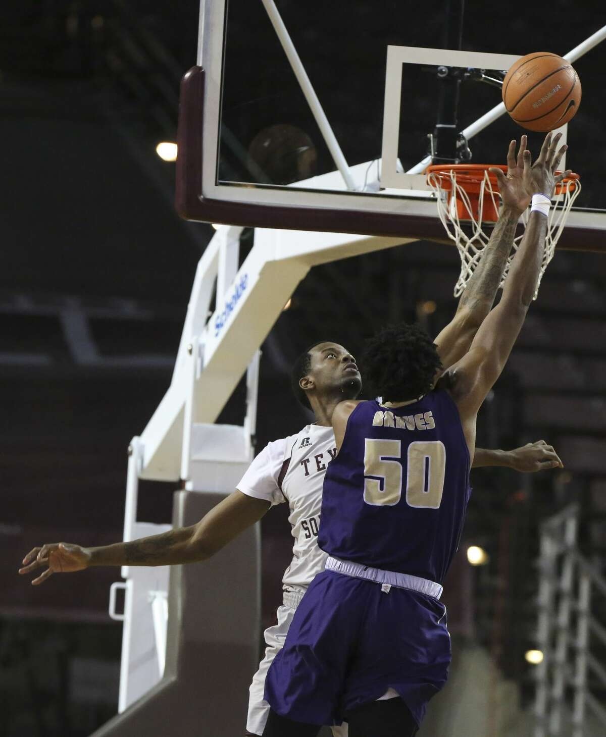 Texas Southern Tigers center Trayvon Reed (5) tries to block Alcorn State Braves forward Devon Brewer (50) during the second half of a Southwestern Athletic Conference game at Health & Physical Education Arena on Wednesday, Jan. 3, 2018, in Houston. The Texas Southern Tigers defeated the Alcorn State Braves 85-70. ( Yi-Chin Lee / Houston Chronicle )