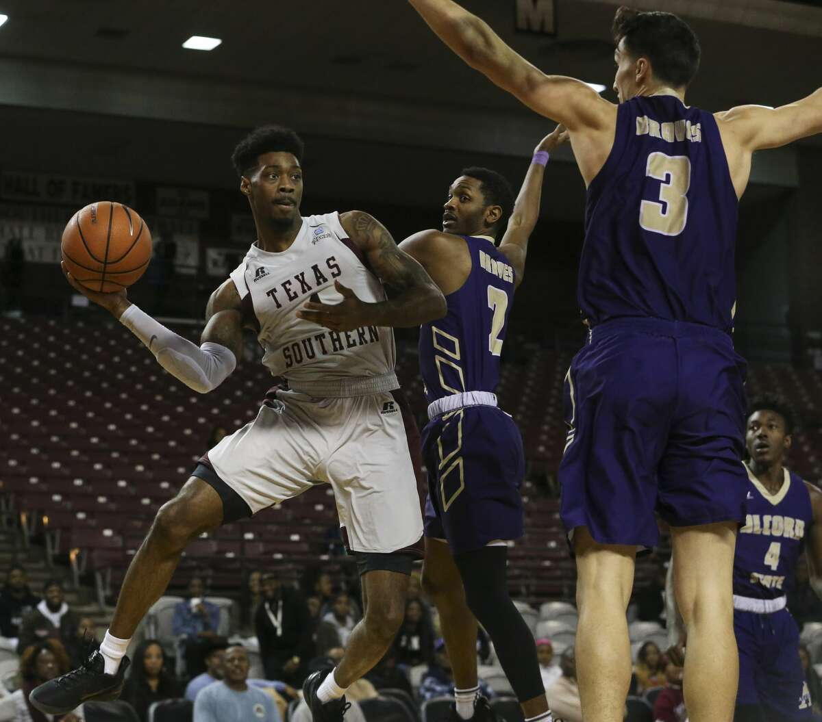 Texas Southern Tigers guard Donte Clark (1) makes a pass while covered by Alcorn State Braves players A.J. Mosby (2) and Tyler Carter (3) during the first quarter of a Southwestern Athletic Conference game at Health & Physical Education Arena on Wednesday, Jan. 3, 2018, in Houston. ( Yi-Chin Lee / Houston Chronicle )