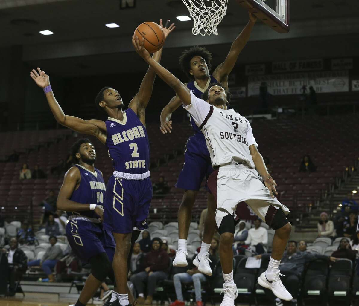 Texas Southern Tigers guard Derrick Bruce (2) goes for the basket while Alcorn State Braves players A.J. Mosby (2) and Troymain Crosby (23) is trying to stop him during the second half of a Southwestern Athletic Conference game at Health & Physical Education Arena on Wednesday, Jan. 3, 2018, in Houston. The Texas Southern Tigers defeated the Alcorn State Braves 85-70. ( Yi-Chin Lee / Houston Chronicle )