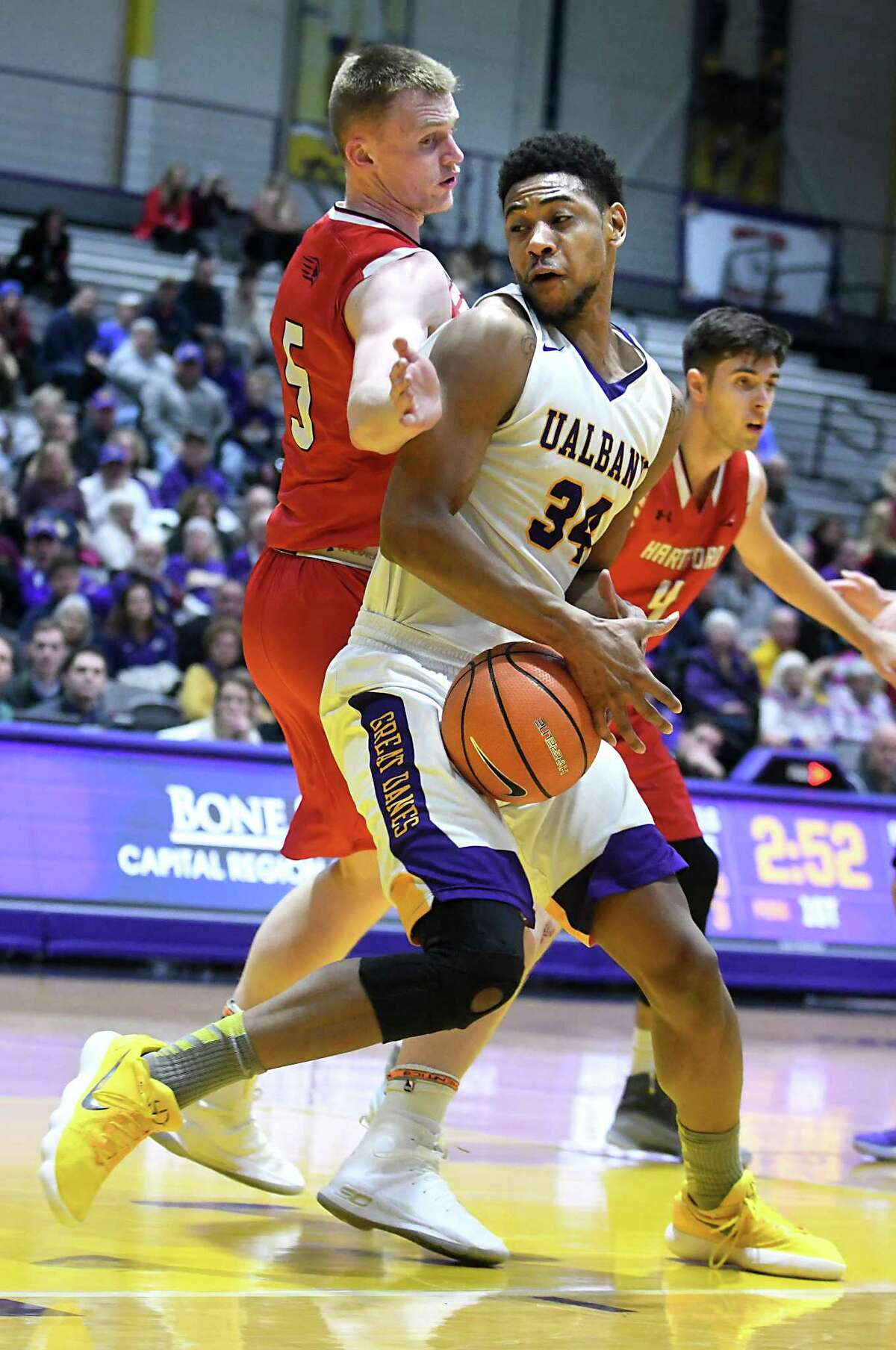 University at Albany's Alex Foster is guarded by Hartford's John Carroll as he makes a move to the basket during a basketball game at SEFCU Arena on Wednesday, Jan. 3, 2018 in Albany, N.Y. (Lori Van Buren / Times Union)