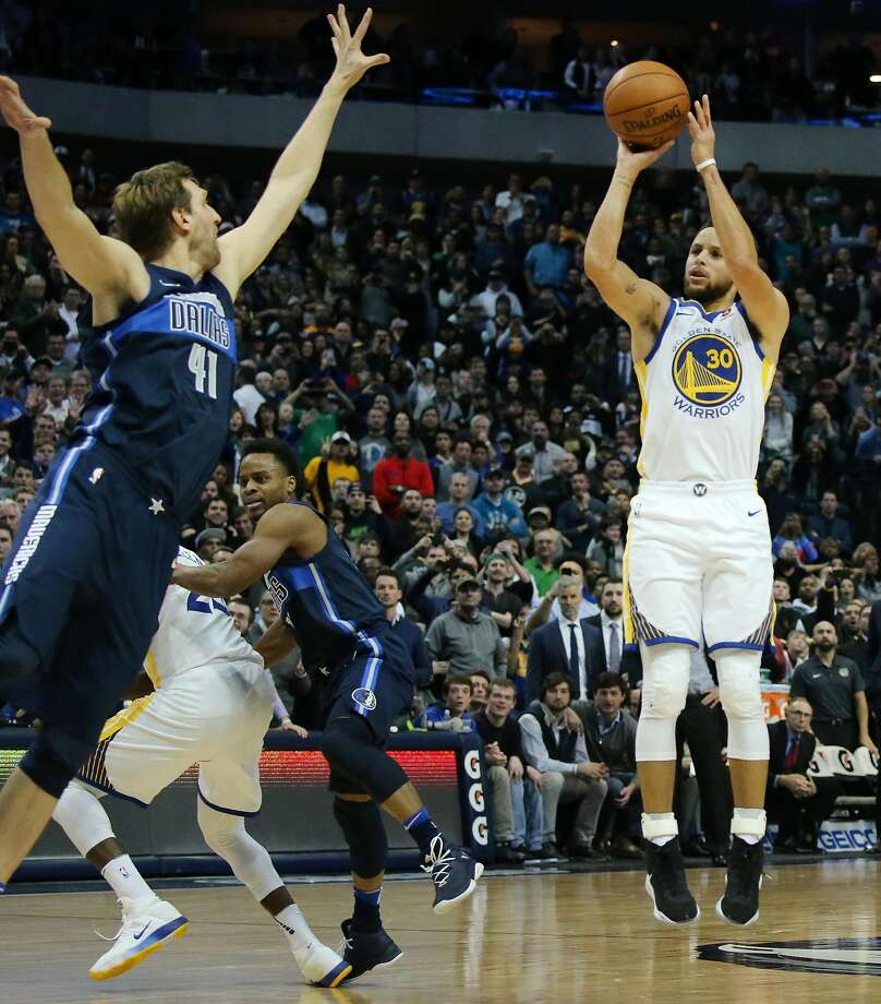 The Golden State Warriors' Stephen Curry (30) shoots the game-winning shot over the Dallas Mavericks' Dirk Nowitzki (41) at the American Airlines Center in Dallas on Wednesday, Jan. 3, 2018. The Warriors won, 125-122. Photo: Andy Jacobsohn, TNS