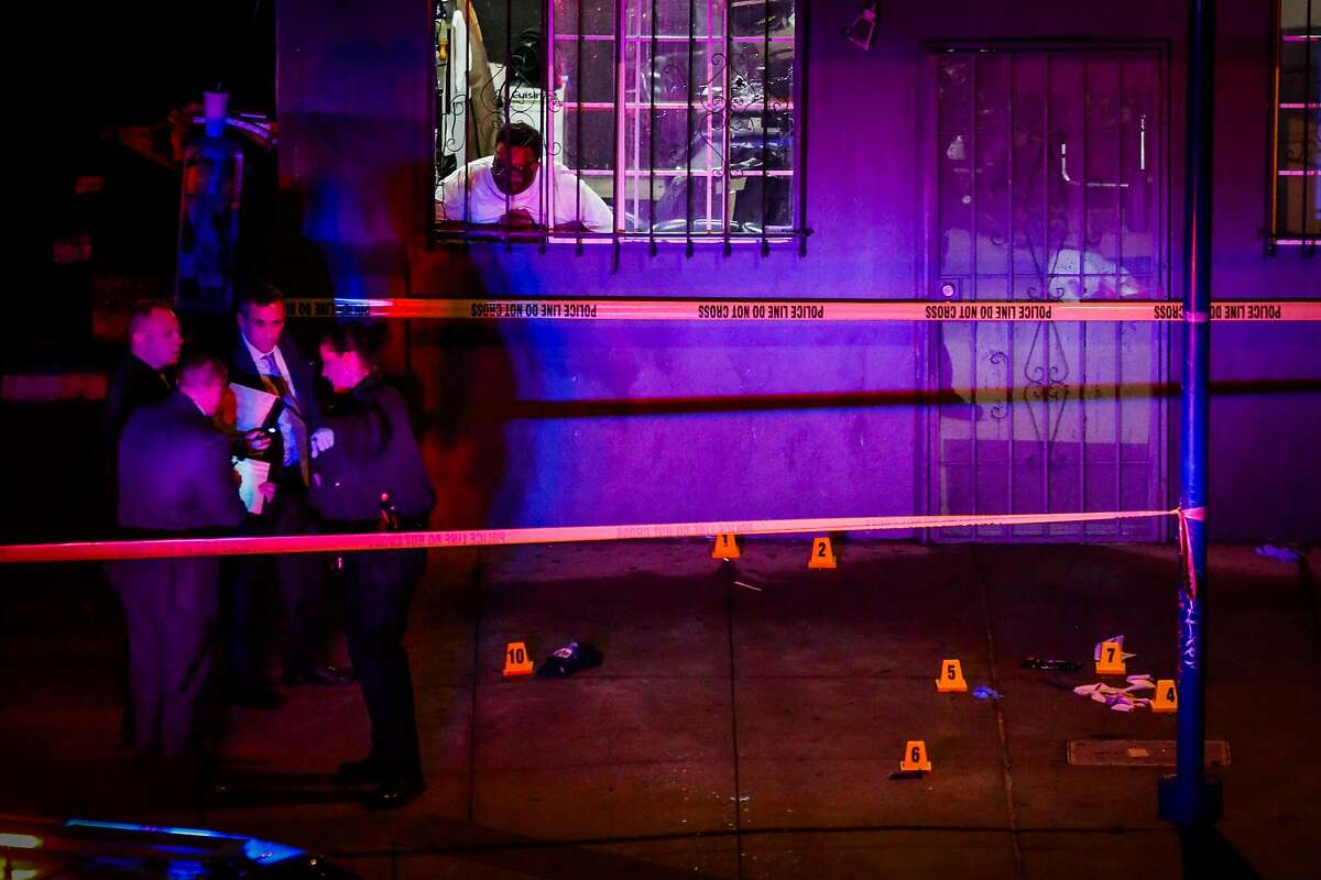 Police officers investigate outside barbershop Upperkutz on 7th and Chester Streets outside the West Oakland Bart Station after a shooting in Oakland, Calif., on Wednesday, Jan. 3, 2018.Sahleem Tindle was killed by police during an incident involving another man.