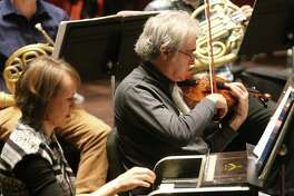 The San Antonio Symphony, shown rehearsing for a 2018 concert, will go dark for the rest of 2020.