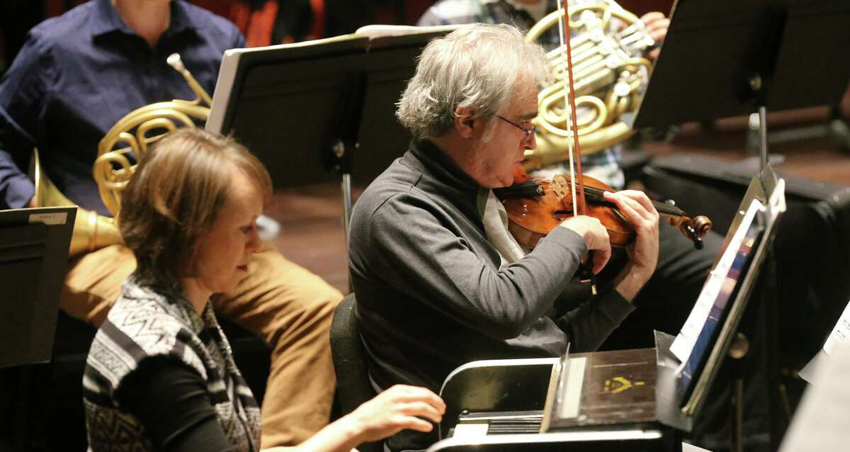 San Antonio Symphony, shown rehearsing for a 2018 concert, will be playing masked and socially distanced in this weekend's concerts. The performances are the orchestra's first in nearly a year.