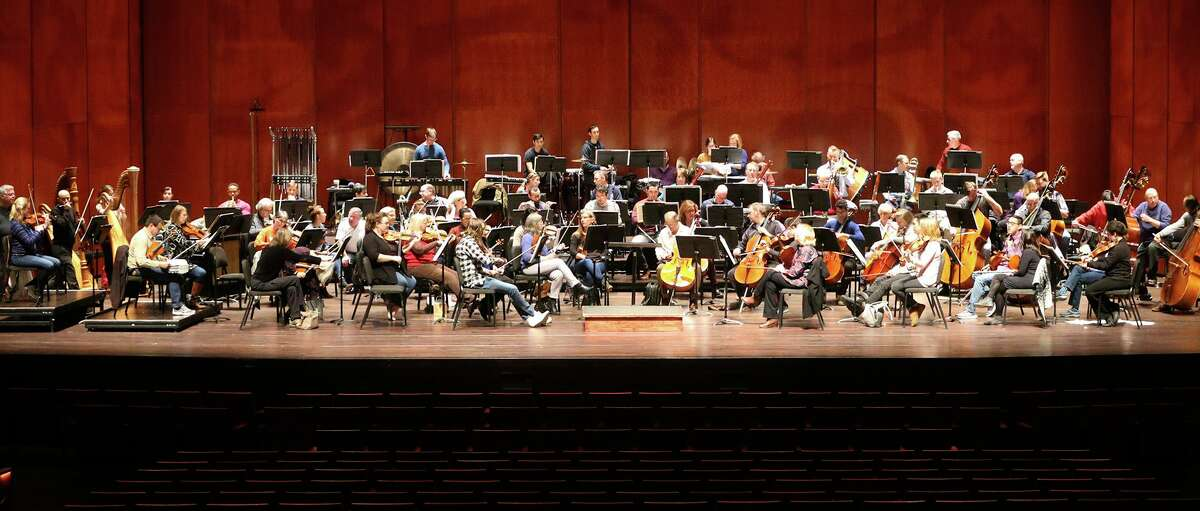 The San Antonio Symphony, shown rehearsing on the stage of the Tobin Center for the Performing Arts, begins its 80th season in September.