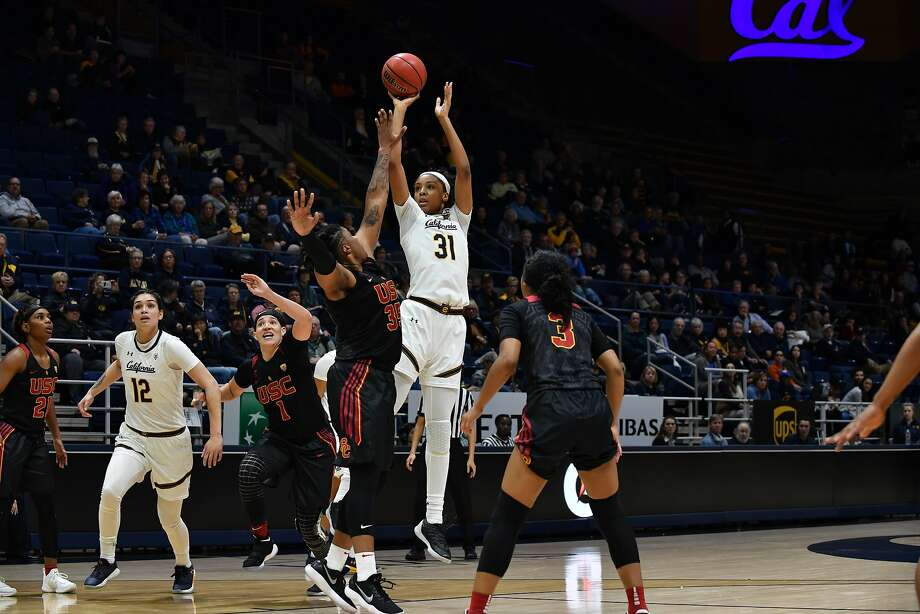 Kristine Anigwe (#31) shoots over USC's Kristen Simon at Haas Pavilion in Berkeley, Calif. on Friday Dec. 29, 2017. Cal went on to win the game 76-64. Photo: KLC Fotos