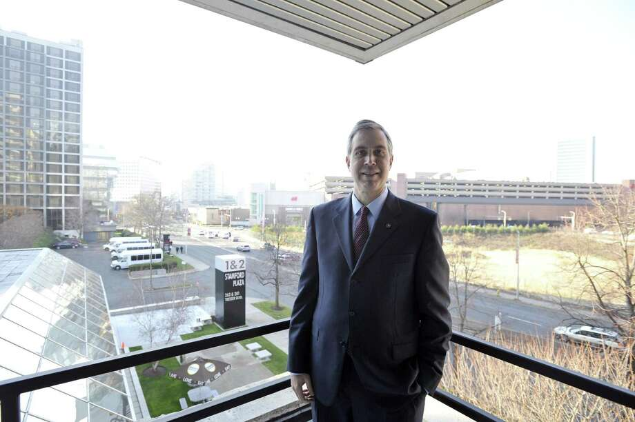 Webster Financial CEO John Ciulla in 2015 at the company's office in downtown Stamford, Conn. On Jan. 4, 2018, Webster pledged to raise its minimum wage to $15 by the end of 2018 and awarding a $1,000 cash bonus to non-executive employees, representing about 70 percent of its workforce. Photo: Michael Cummo / Hearst Connecticut Media / Stamford Advocate