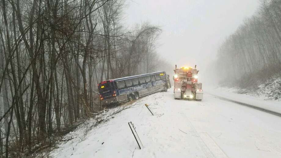 """State Police released this photo of a CT Transit bus that slipped off the road near Marlborough Thursday, Jan. 4, 2018 with a warning: """"stay off the roads if you can."""" No passengers were on the bus, police said. The driver suffered a minor injury. Photo: CSP"""