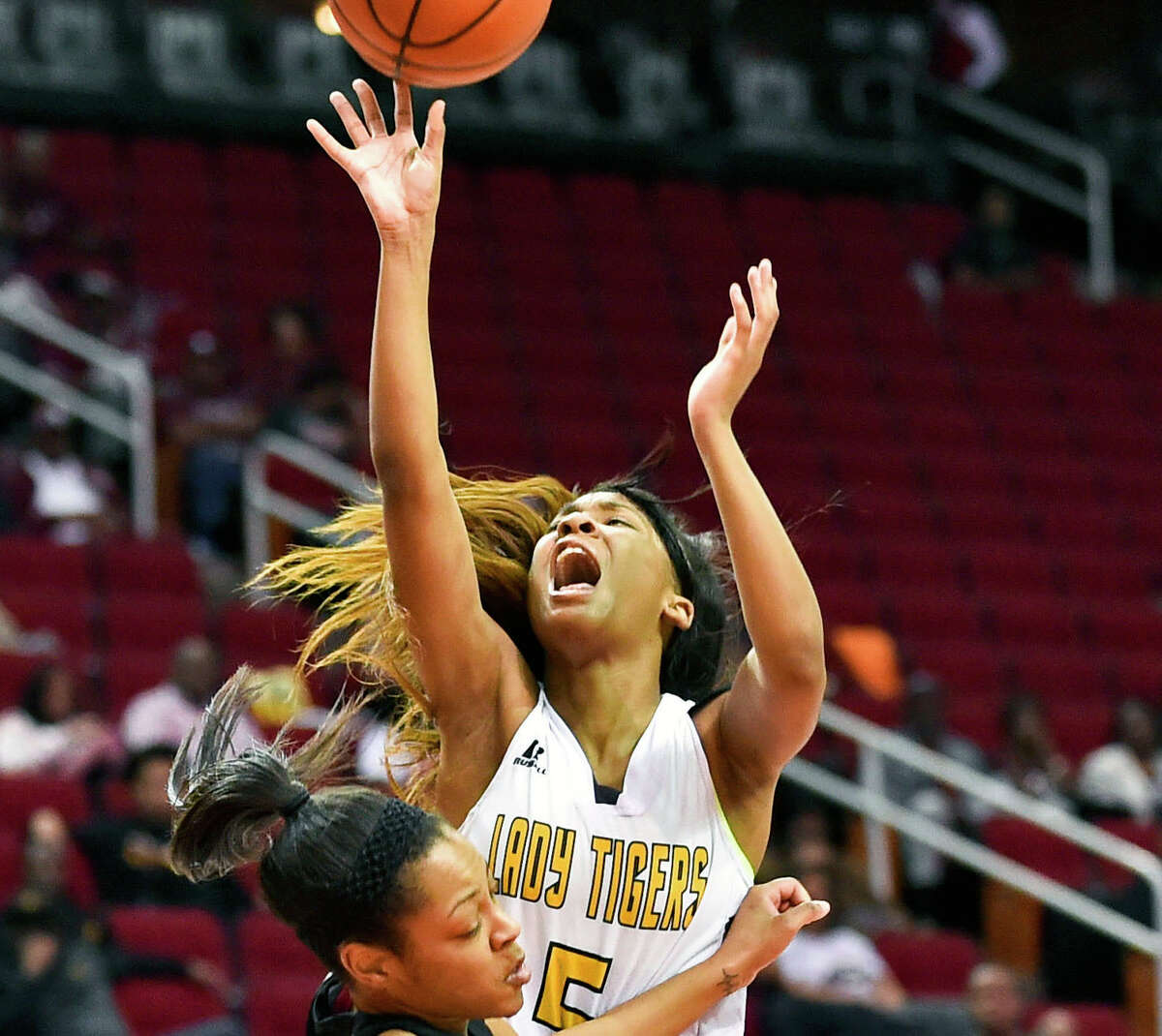 Grambling guard Shakyla Hill (5) shoots over Texas Southern guard Kaitlyn Palmer during the second half of an NCAA college basketball game in the championship of the Southwestern Athletic Conference, Saturday, March 11, 2017, in Houston. TSU won 70-66. Hill's 15 points, 10 rebounds, 10 steals and 10 assists in Grambling State's win over Alabama State on Wednesday gave the junior guard the fourth quadruple-double in NCAA women's basketball history. (AP Photo/Eric Christian Smith)