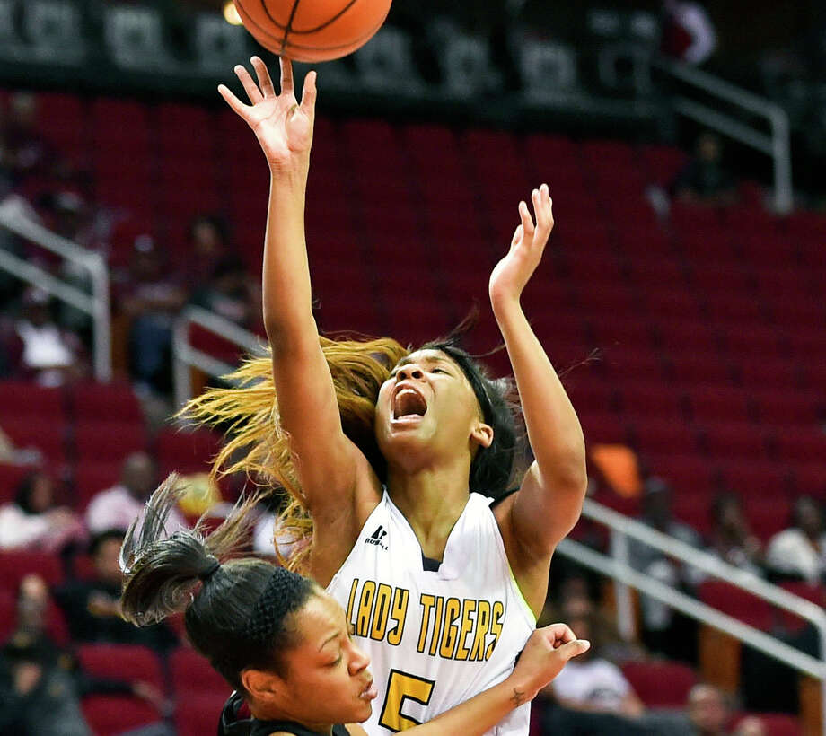 Grambling guard Shakyla Hill (5) shoots over Texas Southern guard Kaitlyn Palmer during the second half of an NCAA college basketball game in the championship of the Southwestern Athletic Conference, Saturday, March 11, 2017, in Houston. TSU won 70-66. Hill's 15 points, 10 rebounds, 10 steals and 10 assists in Grambling State's win over Alabama State on Wednesday gave the junior guard the fourth quadruple-double in NCAA women's basketball history. (AP Photo/Eric Christian Smith) Photo: Eric Christian Smith/AP