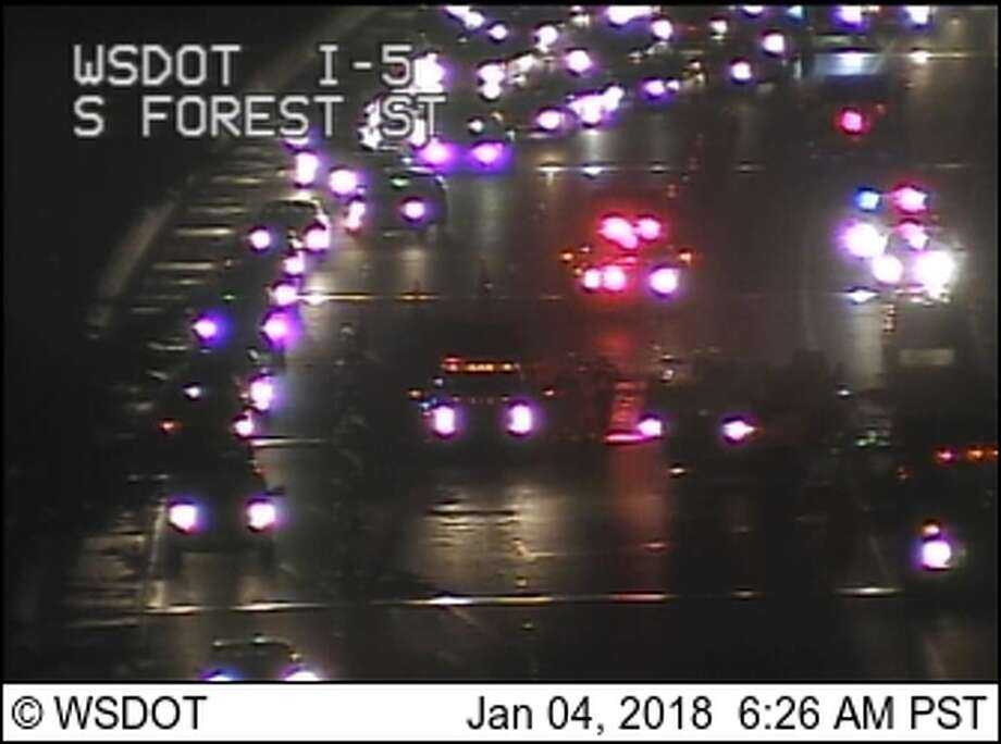 A rollover crash briefly blocked all southbound lanes of Interstate 5 Thursday morning. Photo: WSDOT