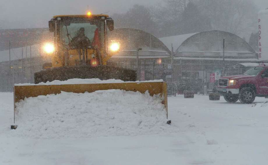 Snow moving equipment is used to clear the parking lot at Stew Leonard's store during the snowstorm Thursday, January 4, 2018, in Norwalk, Conn. Photo: Erik Trautmann, Hearst Connecticut Media / Norwalk Hour