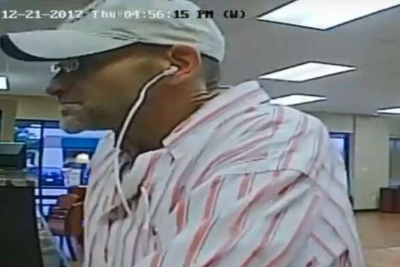Friendswood police are searching for a man who robbed the Texan Bank on Parkwood Avenue on Dec. 21, 2017. The teller reported to police that the suspect smelled like cigarettes, stale beer and body odor.