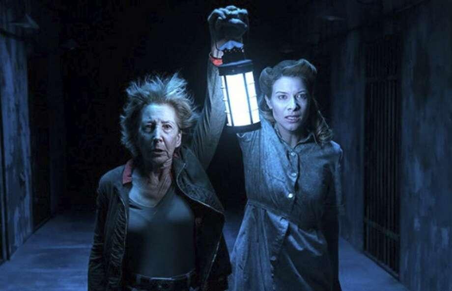 "Lin Shaye as Elise and Tessa Ferrer as Audrey Rainier in ""The Last Key."""