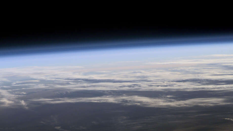 A view of Earth's atmosphere from space. A new study finds that levels of ozone-destroying chlorine are declining, resulting in less ozone depletion. Photo: Credit: NASA