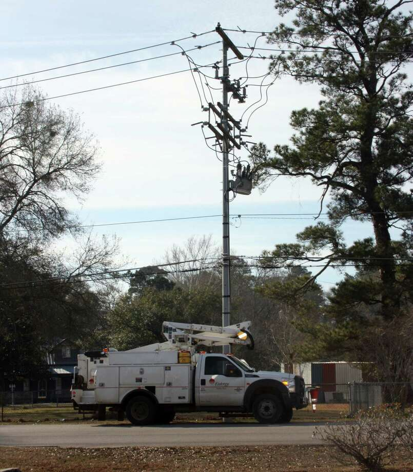 A lineman for Entergy works on restoring power near Southside Elementary in Cleveland Thursday morning. Widespread power outages were reported in the early morning hours Thursday. Entergy says the extreme cold weather is to blame for the overload of the power grid. Photo: Vanesa Brashier