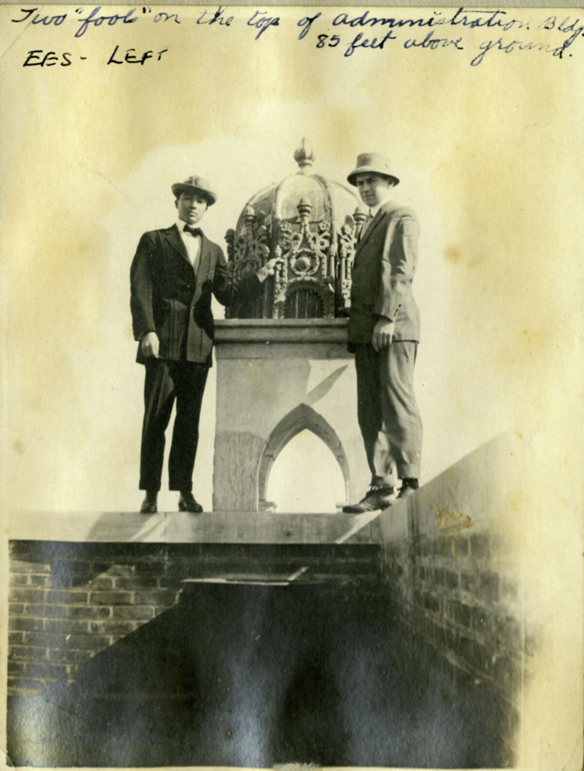 Elmer Shutts, left, is pictured with an unidentified man at the top of Rice University around 1915.