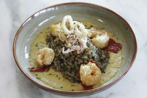 Risotto Nero with black risotto, fried calamari and shrimp bisque from Nonna Osteria.