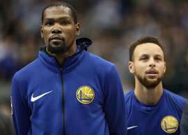 DALLAS, TX - JANUARY 03:  (L-R) Kevin Durant #35 of the Golden State Warriors and Stephen Curry #30 of the Golden State Warriors at American Airlines Center on January 3, 2018 in Dallas, Texas.  NOTE TO USER: User expressly acknowledges and agrees that, by downloading and or using this photograph, User is consenting to the terms and conditions of the Getty Images License Agreement.  (Photo by Ronald Martinez/Getty Images)