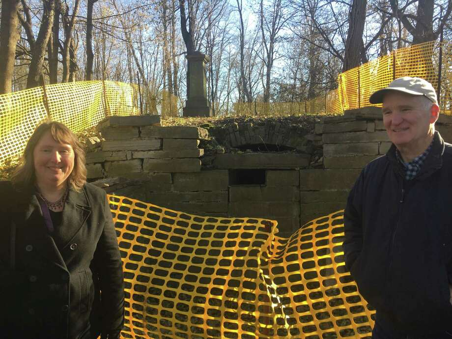 Susan Virgilio, left, with Robert Mullens, right, at the Slingerland family burial vault in Slingerlands in the town of Bethlehem on Dec. 6, 2017. The two Slingerland family members are part of a group trying to restore the vault. Photo: Larry Rulison
