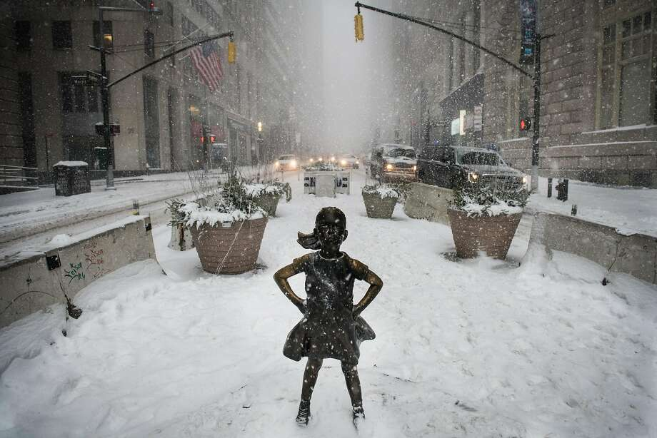A statue of a defiant girl stands during a snow storm in the Financial District of New York, U.S., on Thursday, Jan. 4, 2018. A fast-moving winter storm, growing stronger by the hour, has grounded 3,000 flights, delayed rail travelers in the busy Northeast Corridor and closed schools in New York and Boston. Photographer: Mark Kauzlarich/Bloomberg Photo: Mark Kauzlarich, Bloomberg