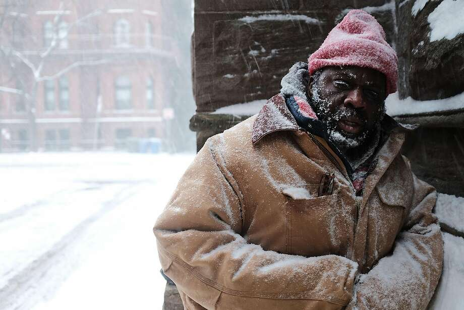 George, who is homeless, pauses in a church alcove, on the streets of Boston as snow falls from a massive winter storm on January 4, 2018 in Boston, Massachusetts. Schools and businesses throughout the Boston area are closed as the city is expecting over a foot of snow and blizzard like conditions throughout the day.  (Photo by Spencer Platt/Getty Images) Photo: Spencer Platt, Getty Images