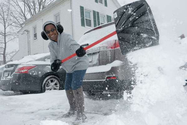 Aenne Dickens clears her driveway of snow along Ward Street during the snowstorm Thursday, January 4, 2018, in Norwalk, Conn.