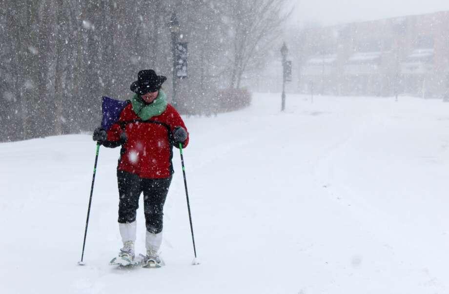 Virginia Hyde snowshoes down Old Ridgefield Road in Wilton on Thursday, Jan. 4, 2018. Photo: Stephanie Kim