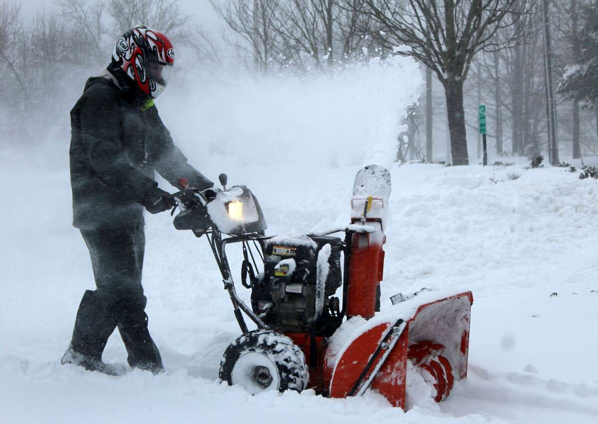 Frank Lema, a crewman for the Wilton Parks and Recreation, clears snow in the Town Hall parking lot on Thursday, Jan. 4, 2018.