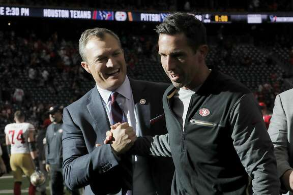 HOUSTON, TX - DECEMBER 10:  Head coach Kyle Shanahan of the San Francisco 49ers celebrates with general manager John Lynch after the game against the Houston Texans at NRG Stadium on December 10, 2017 in Houston, Texas.  (Photo by Tim Warner/Getty Images)