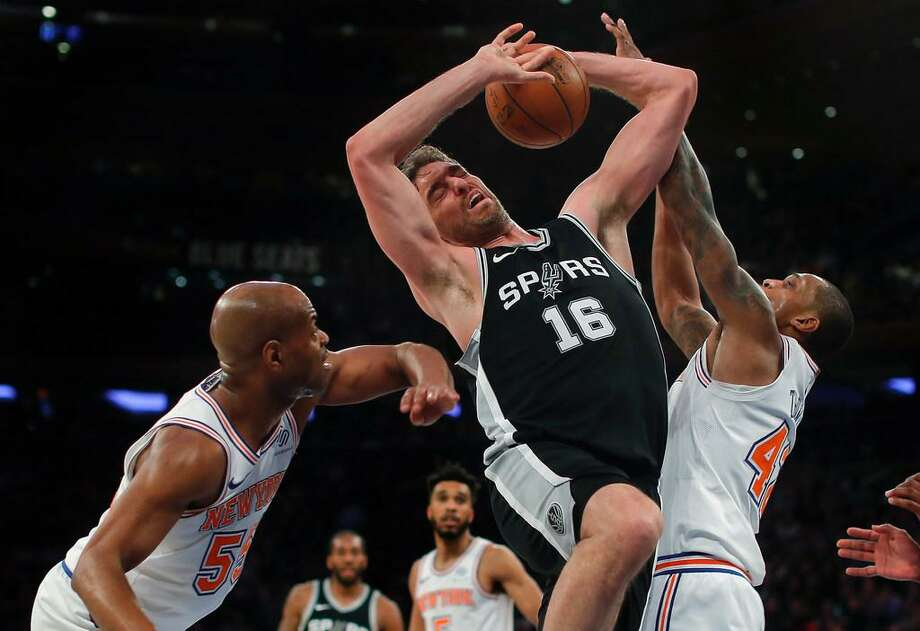 San Antonio Spurs center Pau Gasol (16) battles for a rebound against New York Knicks guard Jarrett Jack (55) and forward Lance Thomas (42) during the third quarter of an NBA basketball game, Tuesday, Jan. 2, 2018, in New York. The Spurs won 100-91. Photo: Julie Jacobson /AP Photo