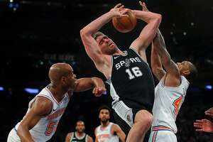 San Antonio Spurs center Pau Gasol (16) battles for a rebound against New York Knicks guard Jarrett Jack (55) and forward Lance Thomas (42) during the third quarter of an NBA basketball game, Tuesday, Jan. 2, 2018, in New York. The Spurs won 100-91.