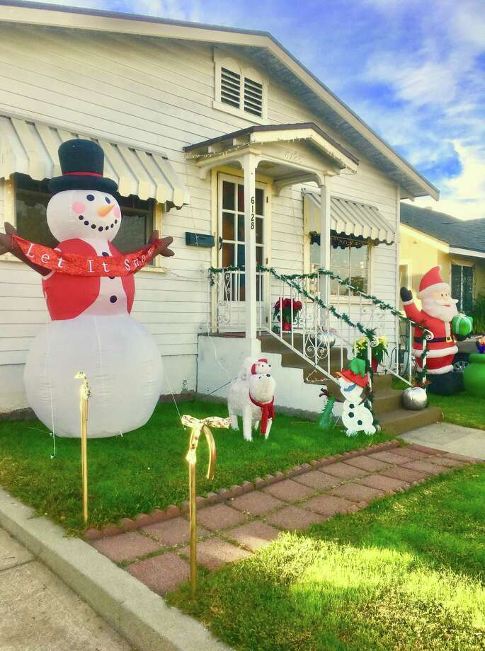 """A homeowner in sunny Los Angeles got into the Christmas spirit, including a snowman fantasizing, """"Let it snow."""" Photo: Contributed Photo / Jennifer Kaylin"""