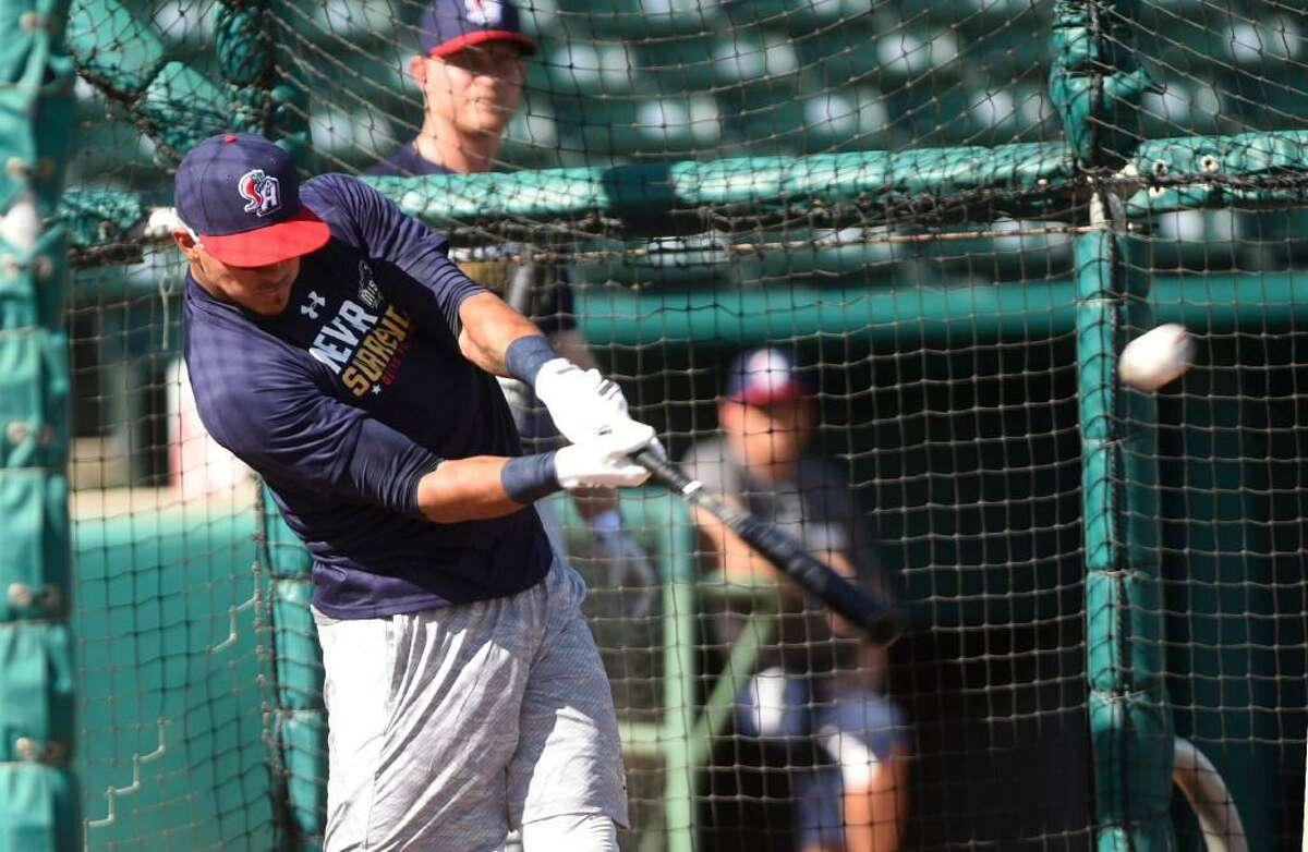 Outfielder Alberth Martinez hits in the batting cage during the San Antonio Missions annual media day workout at Nelson Wolff Stadium on Tuesday, April 4, 2017.