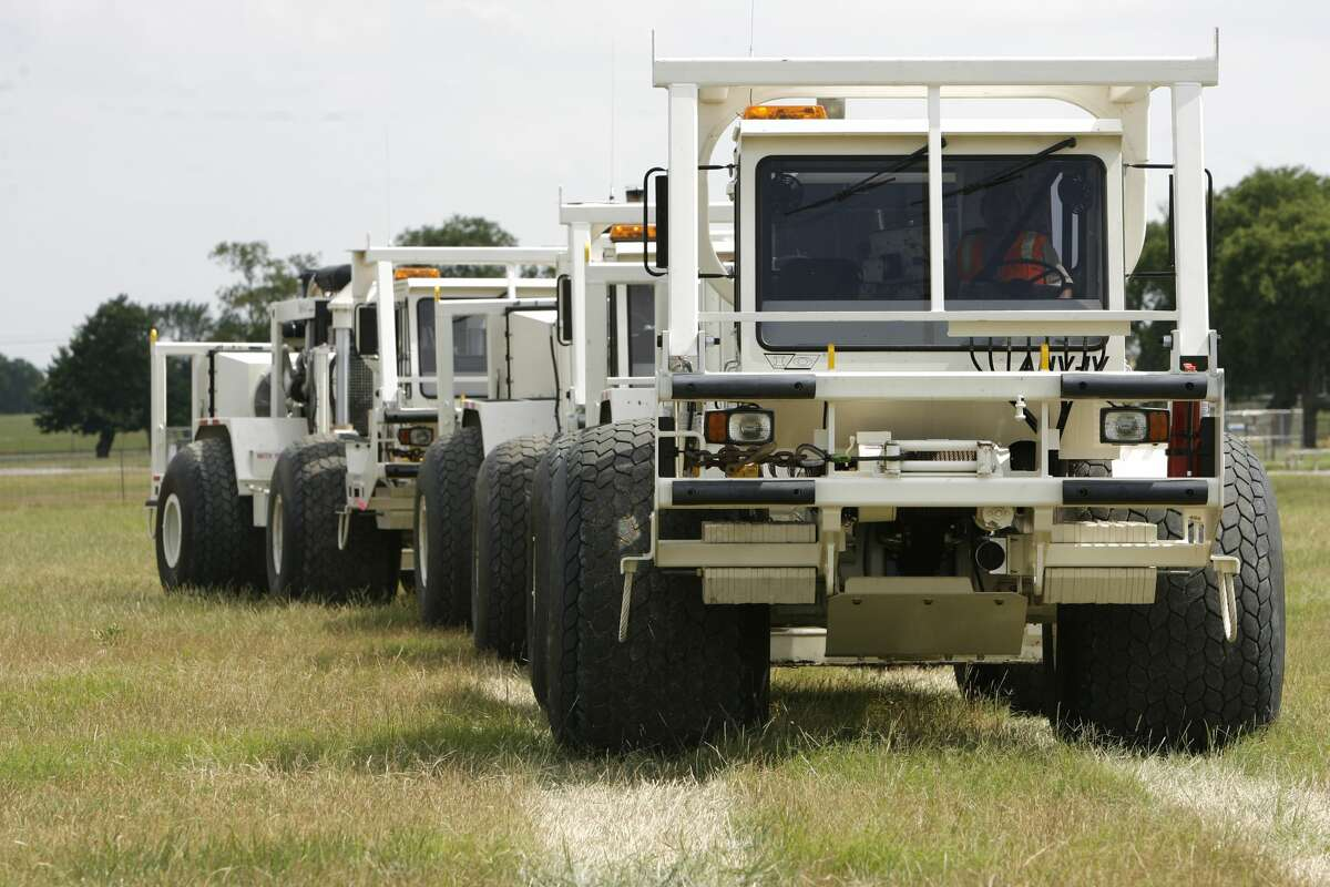 Residents of northeast Midland subdivisions are already seeing Dawson Geophysical's yellow recording boxes. The company is preparing to conduct a seismic survey in northeast Midland from north of Loop 250 down towards Greenwood. When the survey is underway, residents will get a brief visit from Dawson's vibrator trucks, as seen in this photo, with escorts from Dawson scout vehicles and local law enforcement vehicles.