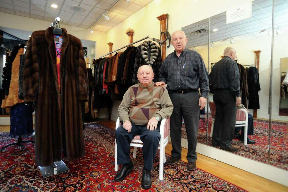 Brothers and Engel's Furs co-owners Paul Nanos, left, and Denis Nanos pose for a photo inside their shop at 115 Bedford St., in downtown Stamford, Conn., on Wednesday, Jan. 3, 2017. Photo: Michael Cummo / Hearst Connecticut Media / Stamford Advocate