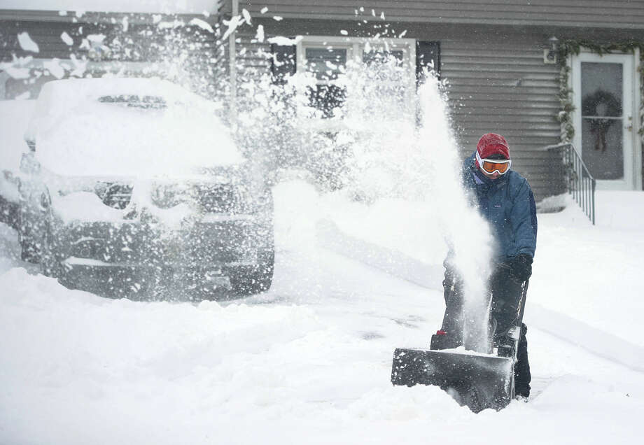 Jonathan Sawitsky uses a snowblower to clear snow from his drivway on Judith Drive in Milford, Conn. on Thursday, January 4, 2018. Photo: Brian A. Pounds, Hearst Connecticut Media / Connecticut Post