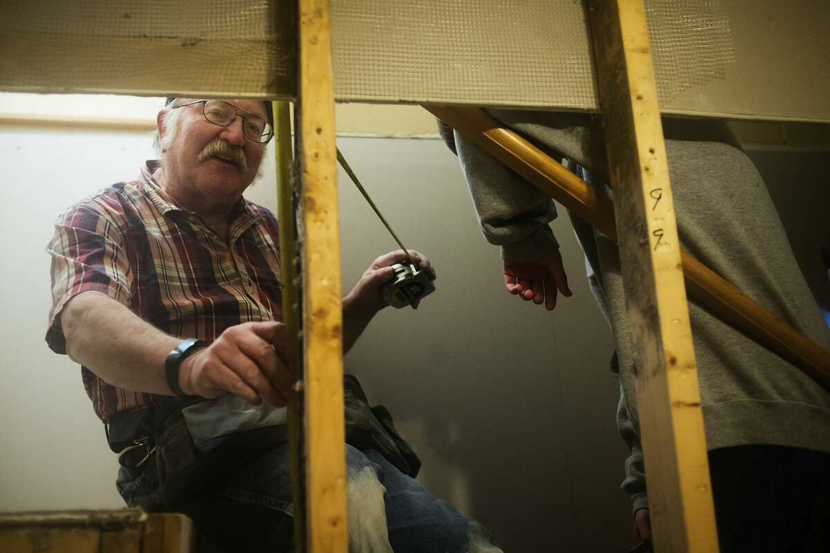 John Potts of St. Charles works to install drywall inside the home of Mike Lacusta and his family on Thursday, Dec. 28, 2017 in Midland. Volunteers from Chesaning United Methodist Church, working through the United Methodist Committee on Relief, helped to repair the Lacustas' basement, which was damaged by flooding in June. (Katy Kildee/kkildee@mdn.net)