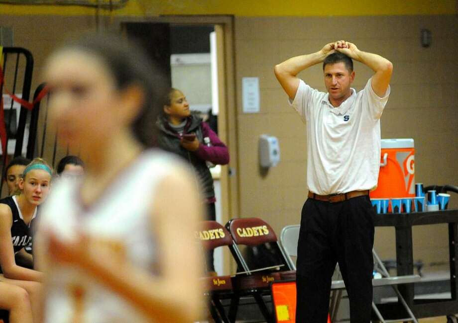 Staples girls basketball coach Paco Fabian looks on during a recent Wreckers win. Staples sits on top of the standings in the FCIAC West Division and are 6-1 looking for a trip back to the CIAC State Playoffs Photo: Christian Abraham / Hearst Connecticut Media