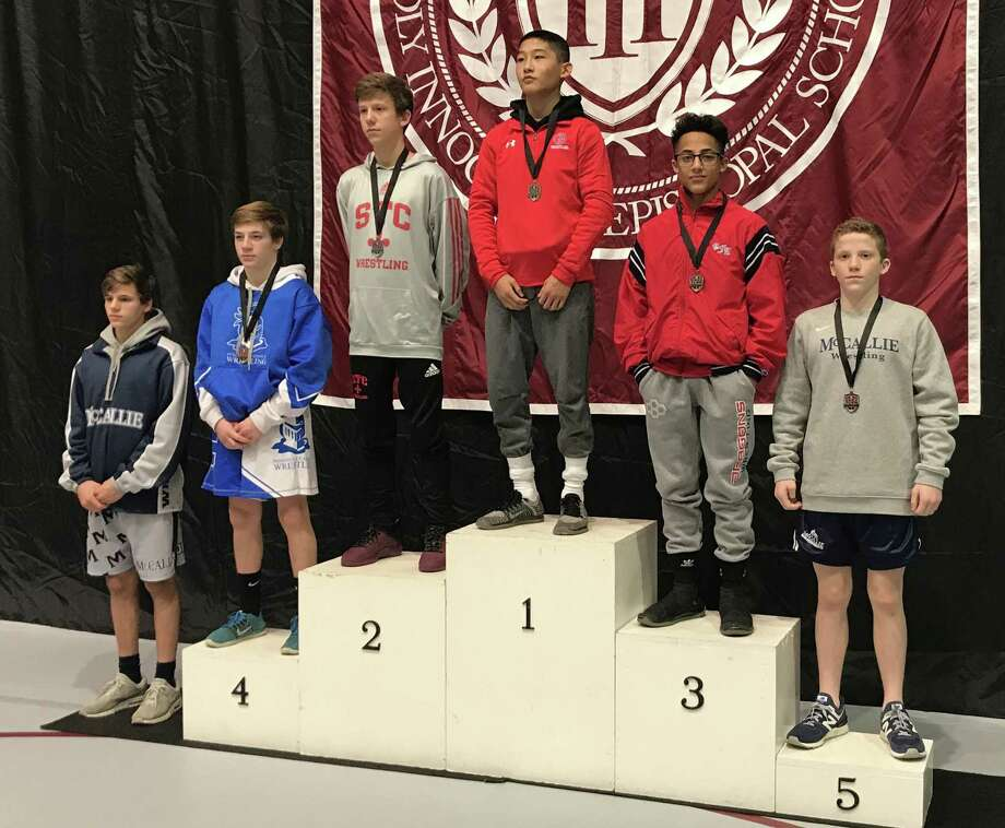 GFA freshman Nico Provo, second from right, made the podium at the Prep Slam Wrestling Tournament in Atlanta. Provo, competing at 106 pounds, went 4-1 to place third. Three other Dragons won a match at the event. Photo: Greens Farms Academy Athletics /