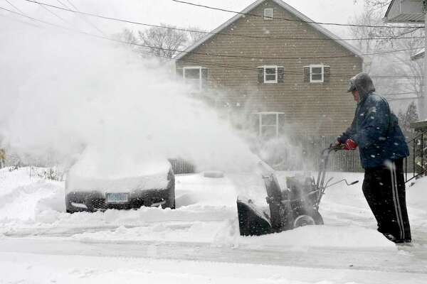 Jorge Domingos uses a snowblower to clear the snow from his driveway on Thursday afternoon. January 4, 2018, in Bethel, Conn.