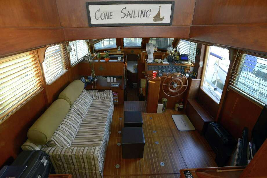 All the comforts of home for Jonathan Asch and Aileen Hutchins, who live on their boat named Huntress during the summer at Palmer Landing in Stamford, Connecticut on Friday, Sept. 22, 2017. Photo: Matthew Brown / Hearst Connecticut Media / Stamford Advocate